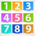 Colorful torn papers numbers Stock Images