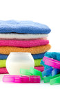 Colorful towels clothes pegs and detergent ball isolated Royalty Free Stock Images