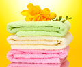 Colorful towels and flowers Royalty Free Stock Photo