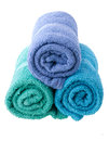 Colorful towels isolated on white background Stock Photo