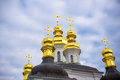 Colorful tower with onion dome and orthodox cross on top. Detail of  christian church made in byzantine russian style. Sky as larg Royalty Free Stock Photo