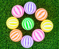 Colorful toy plastic balls on green grass Stock Images