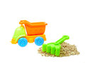 Colorful toy truck with stones and fork isolated on white background Royalty Free Stock Images