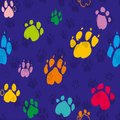 Colorful traces of dog paws eamless pattern.