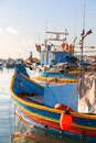 Colorful traditional mediterranean boats marsaxlokk malta typical fisherman village in the south east of early winter morning in Royalty Free Stock Image