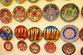 Colorful painted plates hanging on a wall Cappadocia Turkey