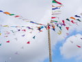 Colorful triangle flags hanging on ropes outdoor Royalty Free Stock Photo