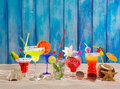 Colorful tropical cocktails at beach on blue wood wall grunge Royalty Free Stock Image