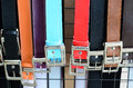 Colorful trouser belts on shop display Royalty Free Stock Image