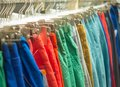 Colorful trousers hanging on sale in store hipster Royalty Free Stock Photography