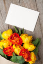 Colorful tulips bouquet and blank greeting card Royalty Free Stock Photo