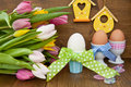 Colorful tulips and easter eggs fresh boiled in cups for Stock Photo
