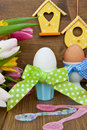 Colorful tulips and easter eggs fresh boiled in cups for Royalty Free Stock Photography