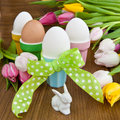 Colorful tulips and easter eggs fresh boiled in cups for Royalty Free Stock Image
