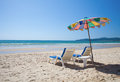 Colorful umbrella and beach beds on sea Royalty Free Stock Photo