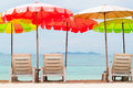 Colorful umbrella and chairs on sand beach Royalty Free Stock Image