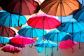 The colorful umbrellas flying towards freedom