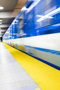 Colorful underground subway train with motion blur and platform Stock Images