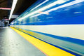 Colorful underground subway train with motion blur and platform Stock Image