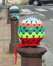 Colorful urban knitting example of the craze of also known as yarn bombing used by enthusiasts to brighten up spaces Stock Images
