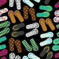 Colorful variation of flip flops summer shoes dark seamless pattern eps10 Royalty Free Stock Photo