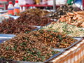 Colorful and variety of street food in downtown bangkok cities in everyday life in thailand here fried bamboo worms Stock Image