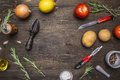 Colorful various of organic farm vegetables lemons, tomatoes, onions, potatoes, rosemary, knife cleaning potatoes place te Royalty Free Stock Photo