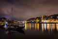 Colorful view of boats moored at twilight along the riverfront with lights reflecting in the Douro River Royalty Free Stock Photos