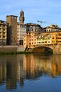Colorful view of ponte vecchio and palazzo vecchio florence italy the is a medieval stone closed spandrel segmental arch bridge Stock Image