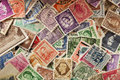 Colorful vintage used postage stamps in a pile Royalty Free Stock Image