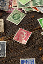 Colorful vintage used postage stamps in a pile Stock Photo