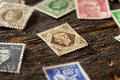Colorful vintage used postage stamps in a pile Stock Images