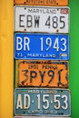 Colorful wall with collection of retired license plates Royalty Free Stock Photo
