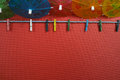 Colorful washline with clothespins and paper umbrellas, copy spa