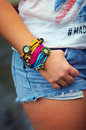 Colorful watch wristband on stylish female hand arm Stock Image