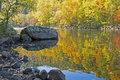 Colorful water reflection on the Pigeon River in fall. Royalty Free Stock Photo