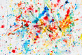 Colorful watercolor splash on white paper Royalty Free Stock Photo