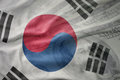 Colorful waving national flag of south korea on a american dollar money background. Royalty Free Stock Photo