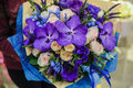 Colorful wedding bouquet with beautiful purple orchid in hands Stock Photos
