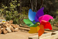 Colorful windmill toy, pinwheel in garden outdoors Royalty Free Stock Photo