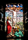 Colorful window with the image of the crucified jesus and mary crying Royalty Free Stock Images