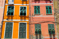 Colorful windows on orange and red walls