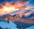 Colorful winter sunrise in the mountains dramatic sky Stock Photos