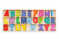 Colorful wooden alphabet in square box. Top view. Isolated on wh Royalty Free Stock Photo