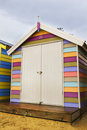 Colorful wooden box a striped house on a cloudy day Stock Photography