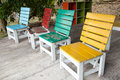 Colorful wooden chairs located on a small chair Stock Photography