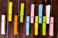 Colorful wooden clothespins on background Stock Photography