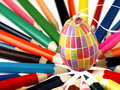 Colorful wooden crayons and easter egg the visible spectrum of colors arranged in a circle Royalty Free Stock Images