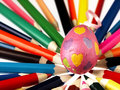 Colorful wooden crayons and easter egg the visible spectrum of colors arranged in a circle Royalty Free Stock Photos