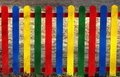 Colorful wooden fence brightly painted in the foreground Royalty Free Stock Photos
